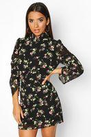 minivestido tejido floral con cuello alto negro