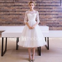 una linea de ilusion de escote longitud de te tul vestido de novia con la cinta de lan ting novia